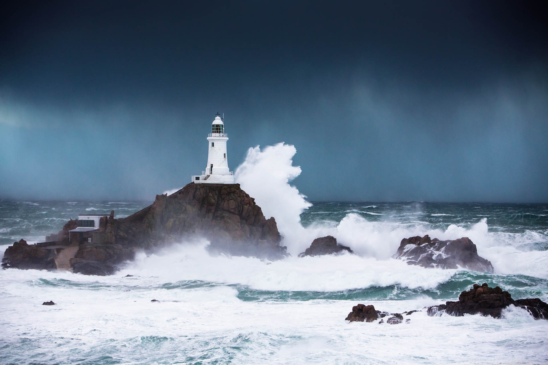 Corbiere Lighthouse surrounded by stormy winter seas